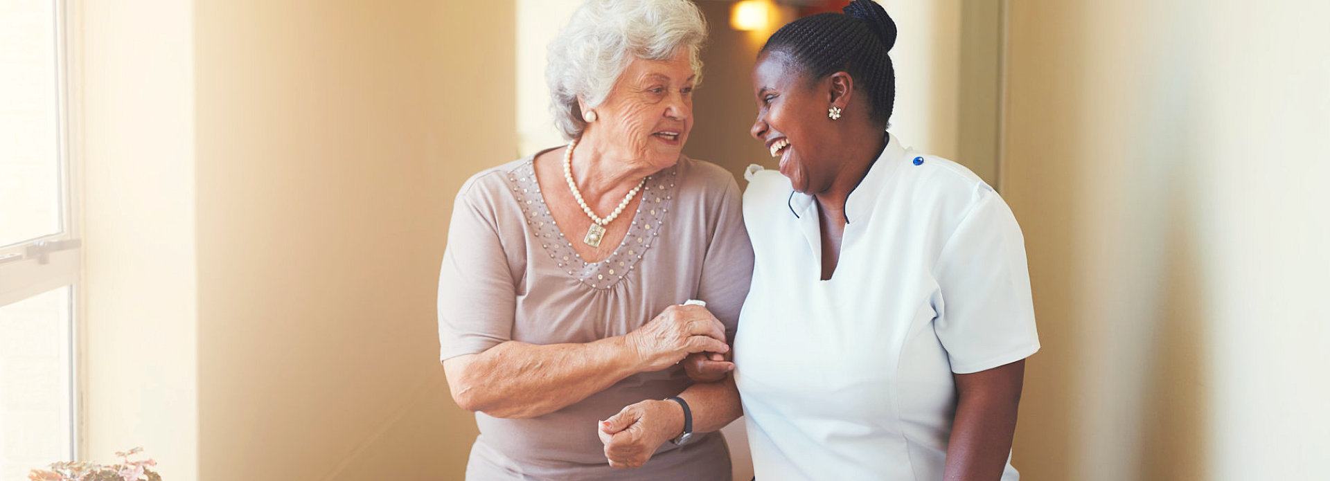 nurse and elderly smiling